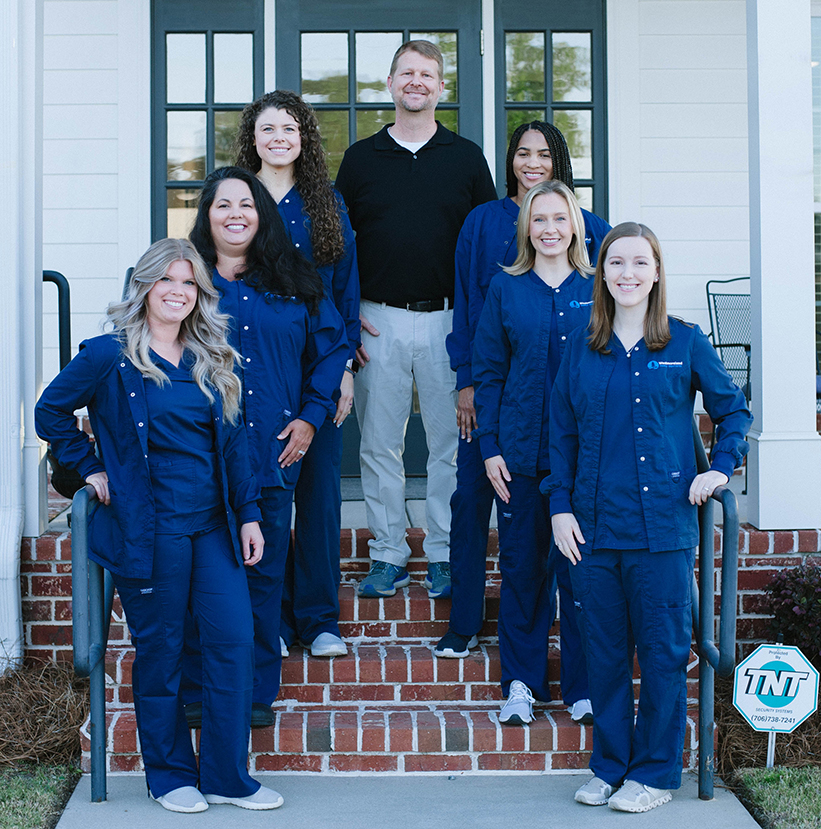 Westmoreland Family Dentistry team on front steps of practice